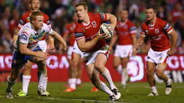 On the move: Ben Creagh of the Dragons runs the ball.