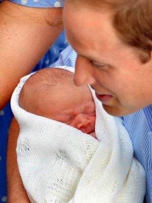 Involved: Prince William holds his newborn son.