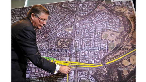 Premier Denis Napthine shows plans for the east-west tunnel.