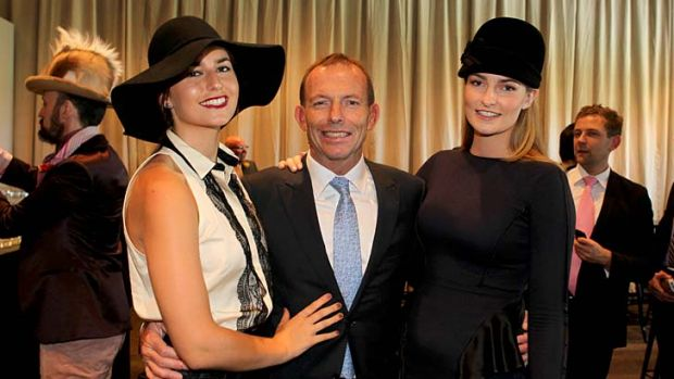 A day at the races: Tony Abbott and daughters.