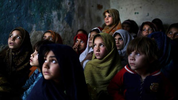 Pakistani schoolgirls, who were displaced with their families from Pakistan's tribal areas due to fighting between ...