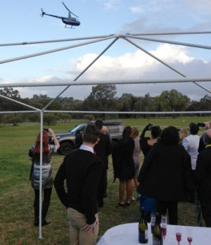 The helicopter arrives at the party.