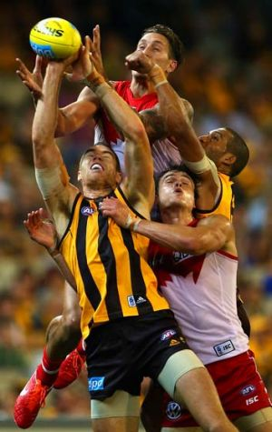 Mike Pyke of the Swans attempts to mark over the top of Max Bailey of the Hawks when the teams met in round seven at the MCG.
