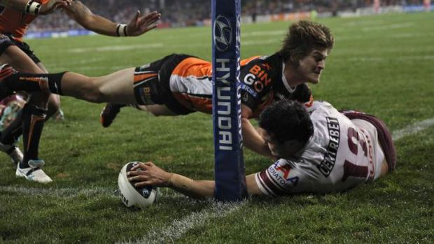 Cornered: Justin Horo plants the ball for one of his two tries on the night.