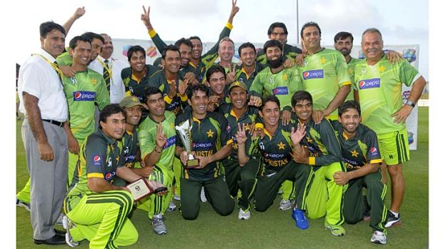 The Pakistan team poses with the trophy after winning the one-day series against the West Indies.