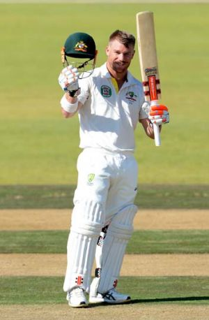 David Warner celebrates after reaching his 100 against South Africa A on July 24.