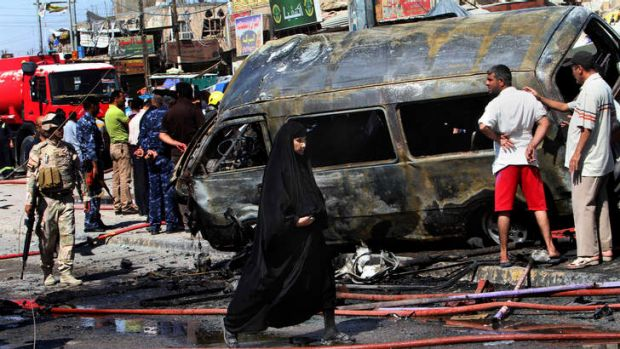 Wave of attacks: A van destroyed by a car bomb in Basra on Monday.