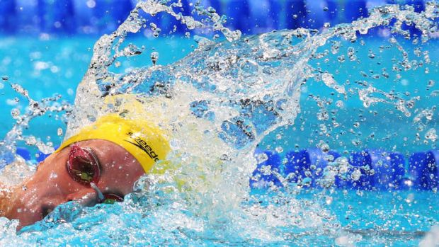 Hanging on: Alicia Coutts during the freestyle leg of the medley relay.