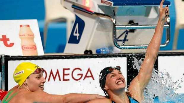 Katinka Hosszu of Hungary celebrates after winning the  200m individual medley ahead of Alicia Coutts (L).