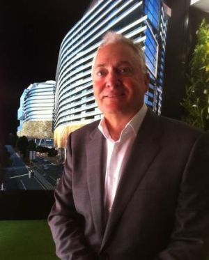 Architect and developer Tony John, from the Anthony John Group in front of an artists impression of his company's ...