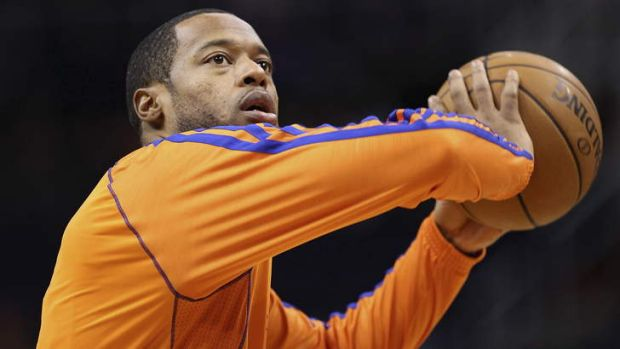 Rocket man: New York Knicks centre Marcus Camby has signed with Houston.