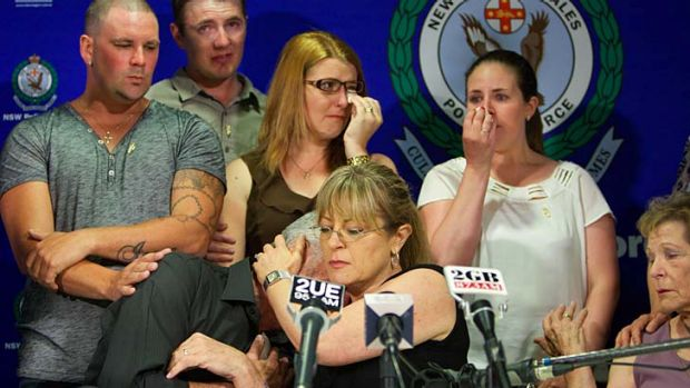 Brian Bradbury is consoled by a family member after breaking down in tears while appealing for help in finding his ...