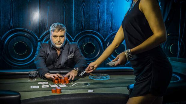 What a card … Kyle Sandilands in poker-playing, whisky-drinking, hard-man mode.