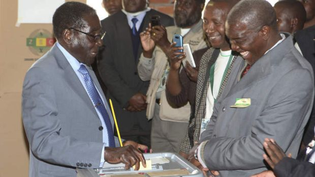 Key poll: Zimbabwean President Robert Mugabe casts his vote in Harare.