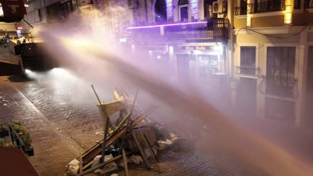Riot police use water cannon to disperse anti-government protesters at Taksim in central Istanbul.