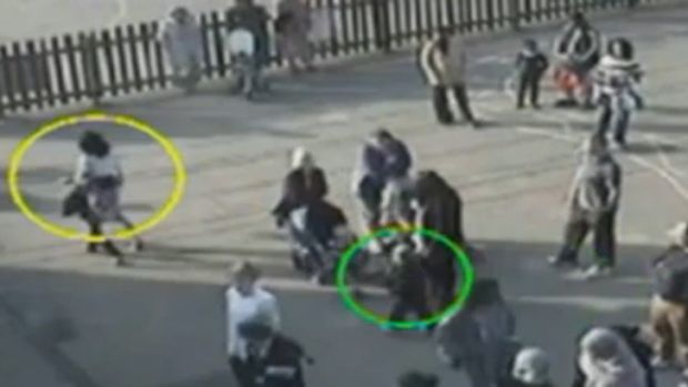 In CCTV footage released to the UK press, little Daniel, right, can be seen trailing after his mother in the schoolyard ...