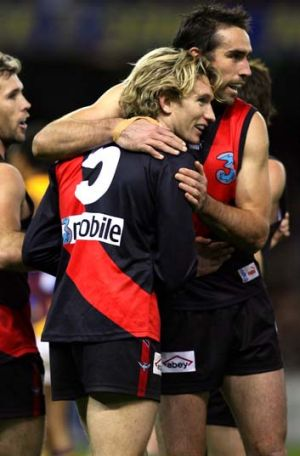 Mark McVeigh, Scott Lucas and James Hird celebrating a goal in their time together at Essendon.