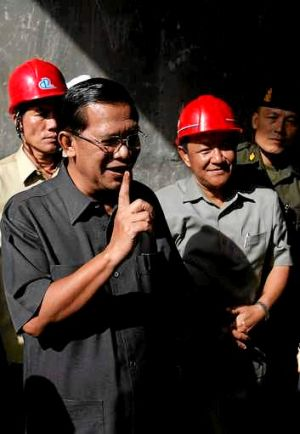 Prime Minister Hun Sen speaks to the media at a bridge construction site in Phnom Penh on Wednesday.
