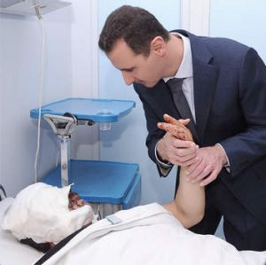 President Bashar Assad visits a patient at a military hospital in Damascus, Syria in 2012. Assad has embraced every tool ...