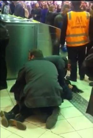 A girl is restrained at Flinders Street station.