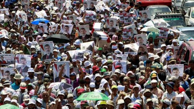 Supporters of deposed Egyptian President Mohammed Mursi march from the Al-Fath Mosque to the defence ministry in Cairo.