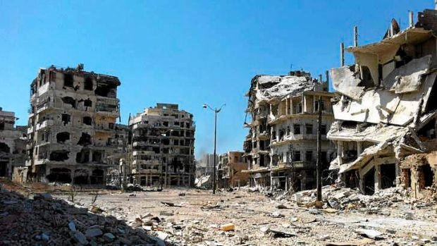 Damaged buildings in  the district of al-Khalidiyah in the central Syrian city of Homs.