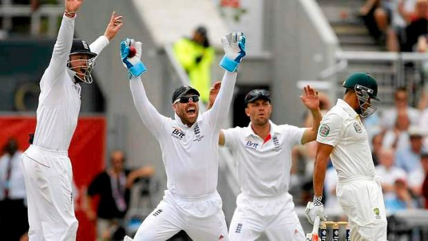 Howler: wicketkeeper Matt Prior celebrates with team mates Ian Bell (L) and Jonathan Trott after dismissing Usman Khawaja.