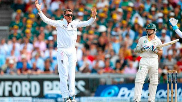 Graeme Swann of England celebrates after taking the wicket of Chris Rogers.