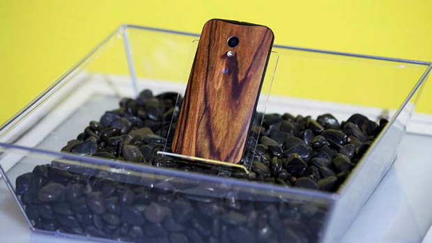A Moto X with a wooden back.