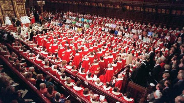 Members of the House of Lords and House of Commons crowd into the Lords debating chamber to hear the Queen's speech.