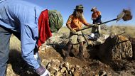 SMH News ? Phil Creaser, Lizard Cannell and Chris Larkin prepare the rock for explosives to be placed inside to break it ...