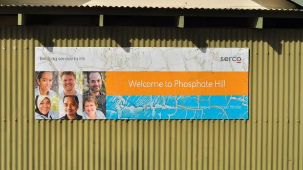 A welcome sign by management company SERCO adorns the side of a building at Phosphate Hill Detention Centre in Christmas ...