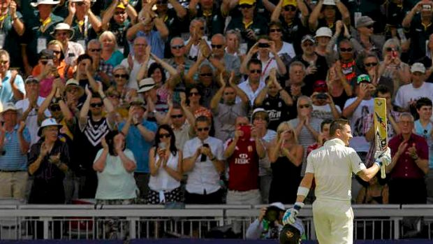 Australia captain Michael Clarke raises his bat to the applause of the crowd after posting his highest score in an ...