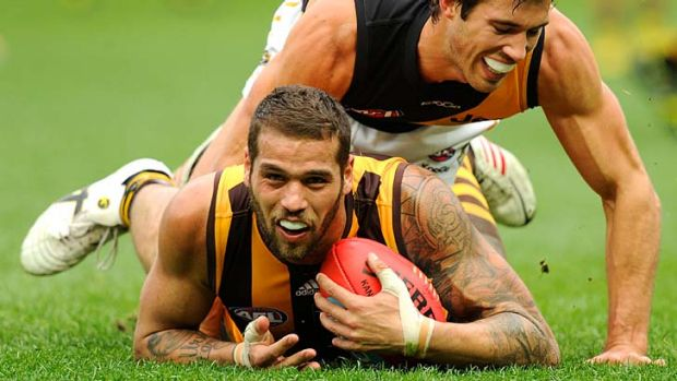 Tiger Alex Rance hampers Hawthorn's Lance Franklin at the MCG.