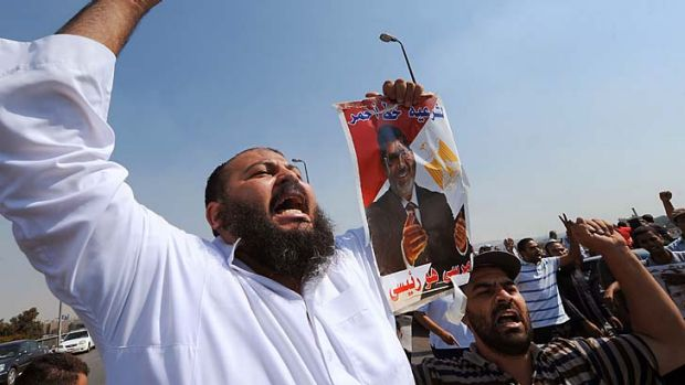 A supporter of Mohamed Mursi protests in Cairo: Police will no longer try to forcefully clear the sit-ins.