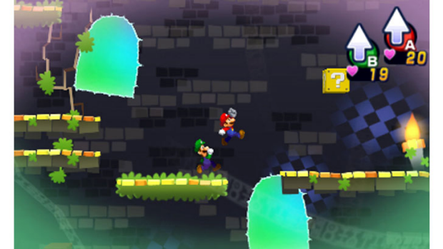 One button makes Mario leap, the other makes Luigi jump.