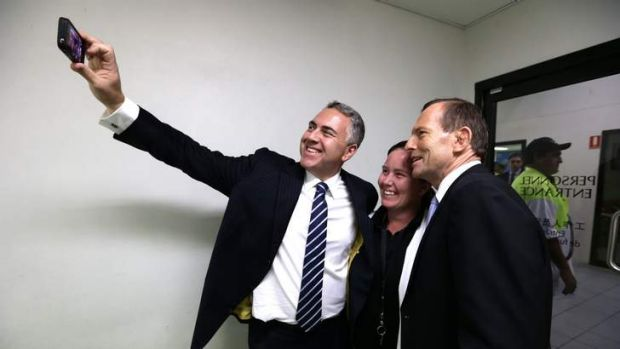 """Shadow treasurer Joe Hockey, Carmel Busby and Opposition Leader Tony Abbott take a """"selfie"""" during their visit to a beef ..."""