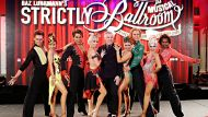 """SYDNEY, AUSTRALIA - AUGUST 05: Baz Luhrmann (C) poses with dancers at the """"Strictly Ballroom The Musical"""" media call at ..."""