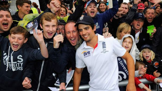 Job done: England captain Alastair Cook, celebrates with fans.