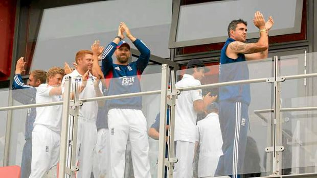 Cursory celebration: England players (from R) Kevin Pietersen, and Matt Prior after play is abandoned.