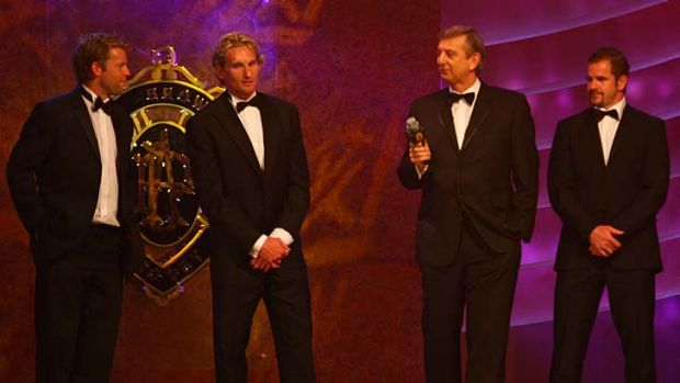 Pillars of the competition. James Hird, second from left, and Mark Ricciuto, far right, at the 2007 Brownlow Medal ...