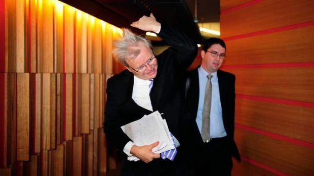 Kevin Rudd in Melbourne at Fairfax's Media House for a 3AW interview...flicking his hair.