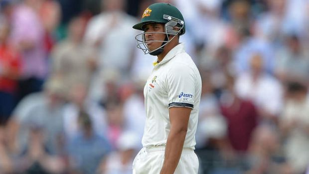 Umpiring shocker: Usman Khawaja walks off after being given out.