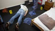 Phd student Luke examines a crime scene as part of the Forensic studies at Deakin University in Geelong.