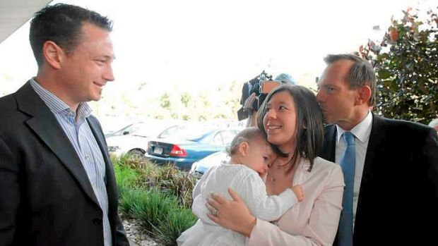 Awkward: Evie Whittaker gets a kiss from Tony Abbott.