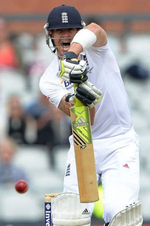 Ton up: Kevin Pietersen celebrates his century in the first innings of the third at Test at Old Trafford.