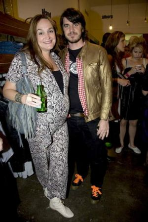 A pregnant Kate Langbroek with husband Peter Lewis.