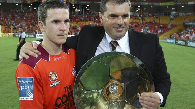 Coming home?: Matt McKay and Ange Postecoglou hold the Premiership Plate after the Roar's victory in 2011.