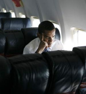 A similar photo shows Barack Obama on a campaign charter during his successful 2008 election campaign.
