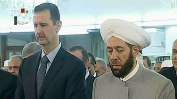 Syrian President Bashar al-Assad and Syrian Grand Mufti Ahmed Hassun attending the morning prayer of Eid al-Fitr in Damascus.